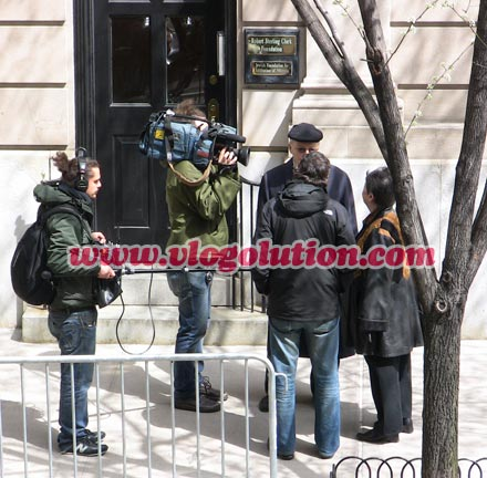 Camera crew filming in front of Bernie Madoff's former Manhattan residence.
